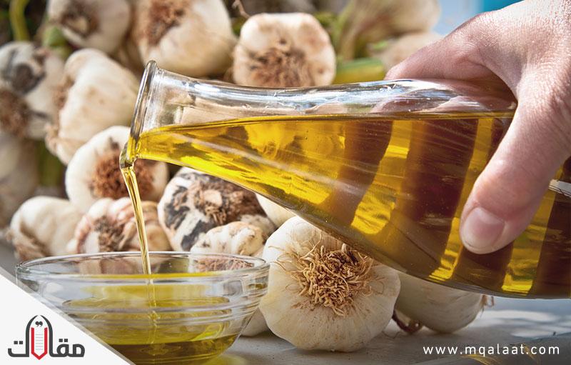 فوائد زيت الزيتون مع الثوم